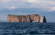 "Percé Rock (French Rocher Percé, ""pierced rock"") is a huge sheer rock formation in the Gulf of Saint Lawrence on the tip of the Gaspé Peninsula in Quebec, Canada, off Percé Bay. (Source - Robert Brown)"